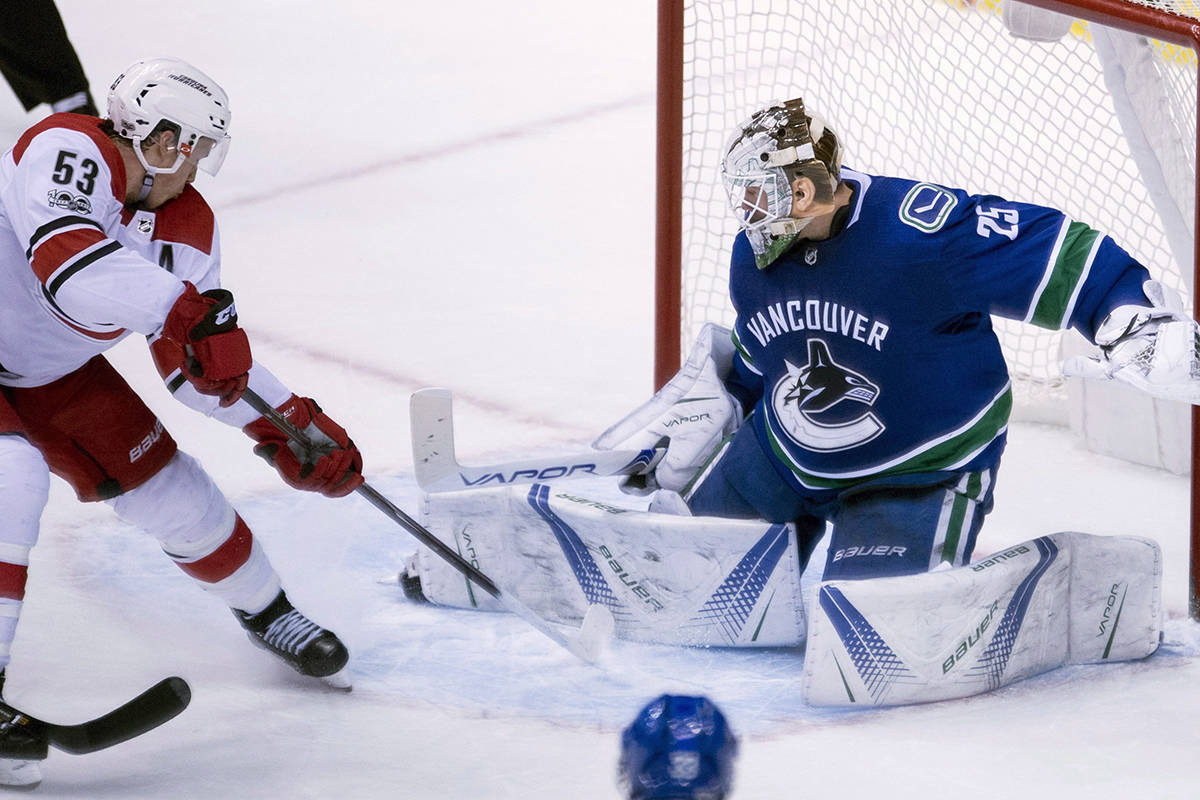 Vancouver Canucks goalie Jacob Markstrom (25) stops a shot from Carolina Hurricanes left wing Jeff Skinner (53) during third period NHL action in Vancouver, Tuesday, Dec. 5, 2017. THE CANADIAN PRESS/Jonathan Hayward