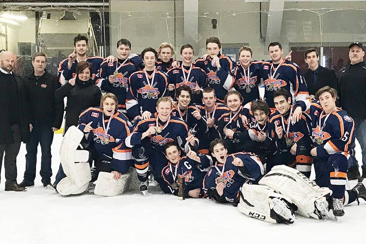 The midget A Kerry Park Islanders celebrate winning the Comox T2 Winter Tournament. Front from left: Liam Bell, Tyson Duffe. Middle: Brendon McDill, Lauchlan McDonald, Tyler McCarty, Danny Bruce, Dawson Bittner, Colton Gareau, Jason McKay, Dallin Foreman. Back: head coach Dean Bruce, assistant coach Jeff Metcalfe, manager Sabine Bell, Ethan Rogers, Aidan Parsons, Wade Mason, Jake Metcalfe, Spencer Hall, Jace Erskine, Lincoln Findlater, Billy Ramwell, Dawsen Foreman, Ken Ramwell (safety). (Submitted)