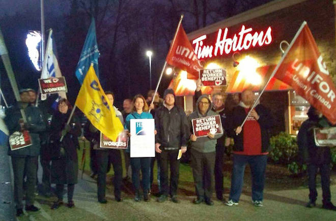 Double-doubles and demonstrations: Employees rally outside Tim Hortons