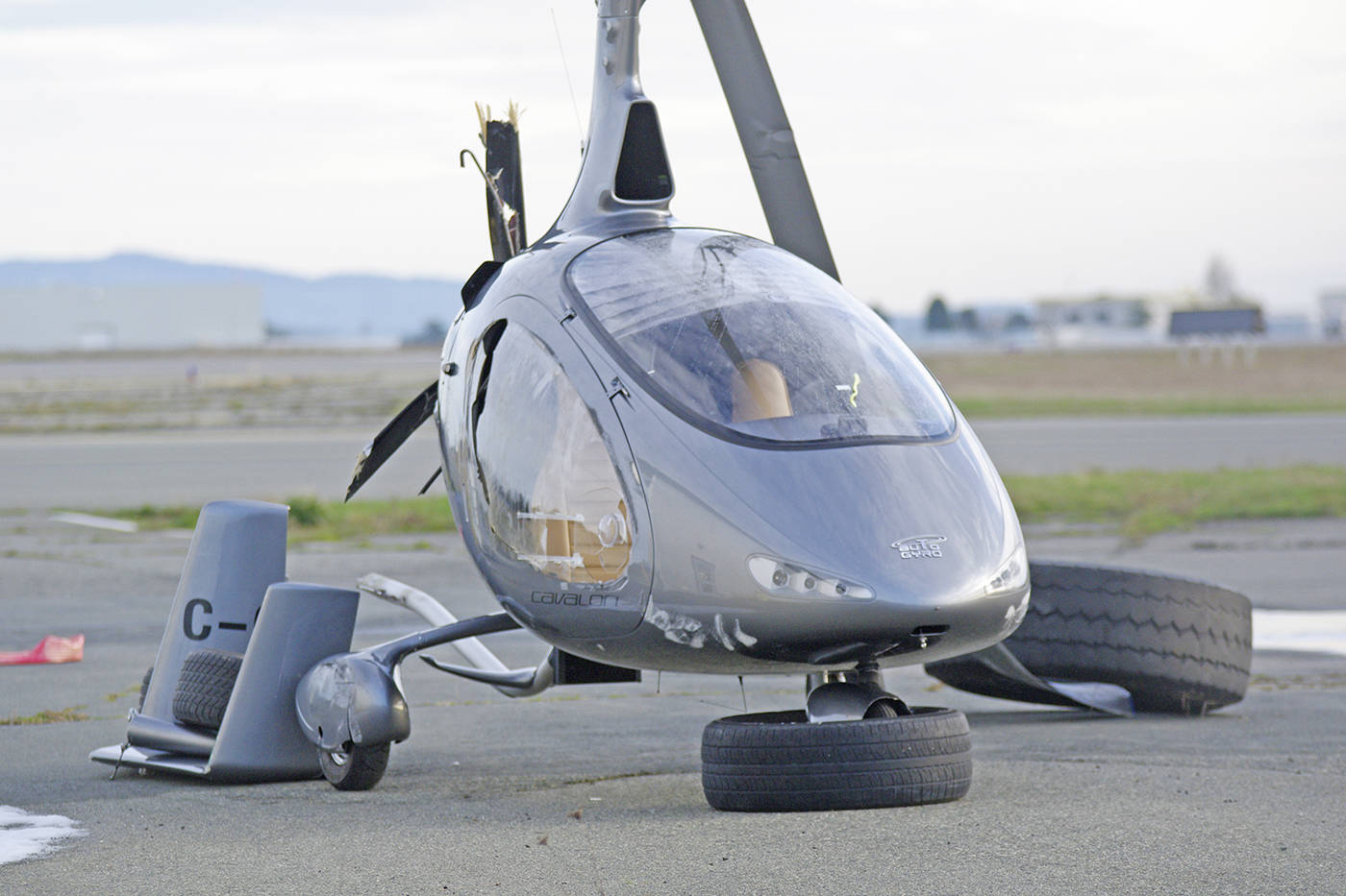A damaged gyrocopter sits near the Victoria Airport Authority's operations centre. One person was injured when the aircraft had a hard landing at the airport on Monday. (Steven Heywood/News Staff)