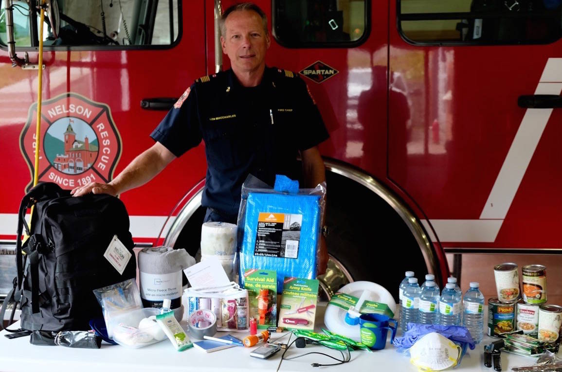 Fire Chief Len MacCharles and his 72-hour evacuation kit that he recommends for all households in Nelson during fire season in case of an evacuation. Photo: Bill Metcalfe