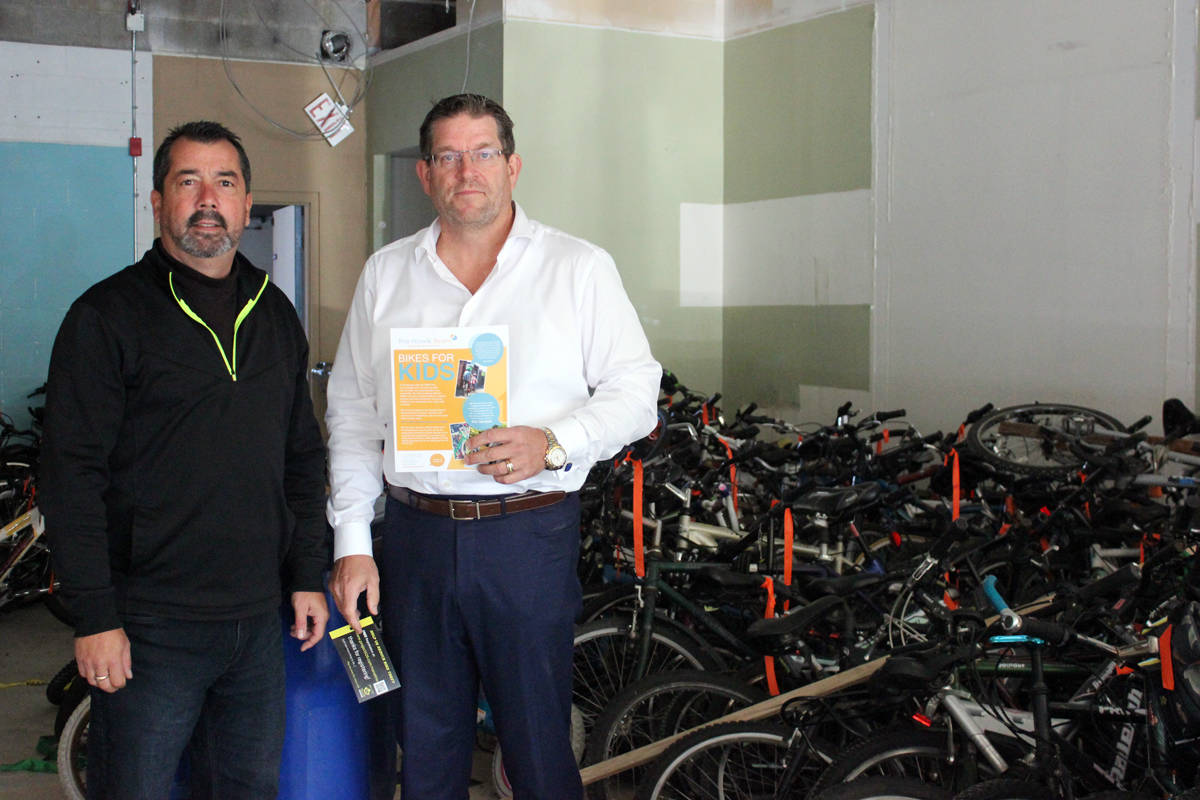 Eddie Goncalves, left, and Greg Nowik, co-founders of Bikes for Kids, examine their storage facility in Nanaimo's Brechin area today, Oct. 10. They say as many as two dozen bikes were stolen from the facility sometime over the Thanksgiving weekend. The bikes were intended to be donated to the less fortunate. (Nicholas Pescod/NEWS BULLETIN)