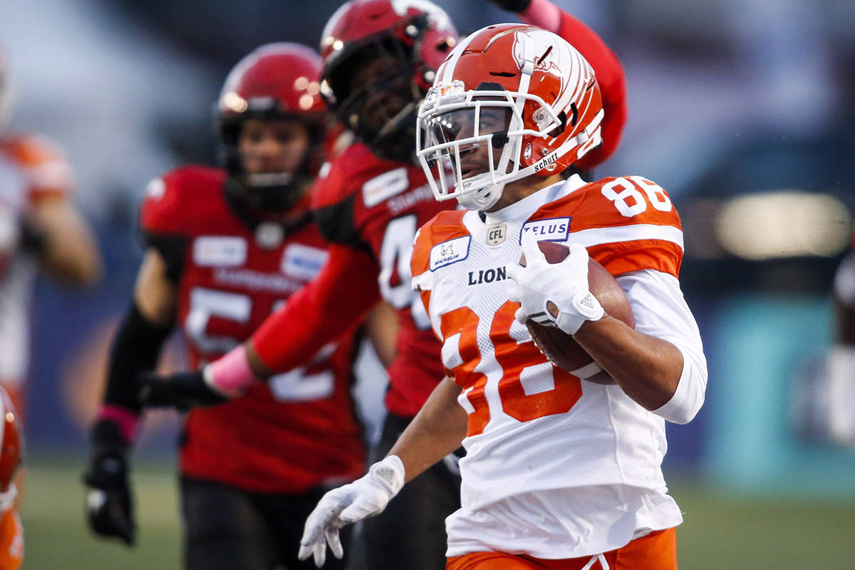BC Lions' Anthony Parker, returns a punt as he is chased by Calgary Stampeders players during CFL football action in Calgary, Saturday, Oct. 13, 2018. THE CANADIAN PRESS/Jeff McIntosh