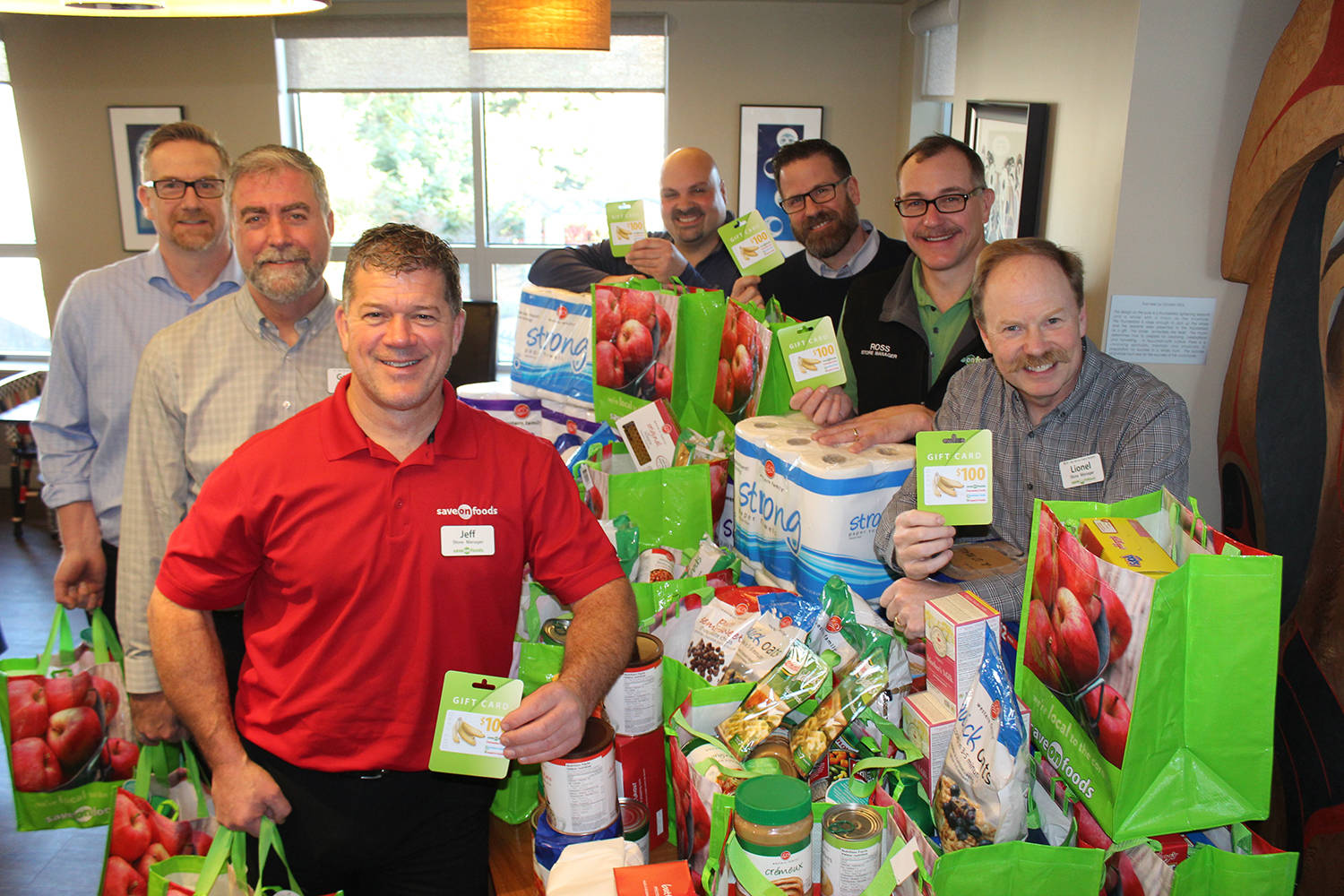 Dave Alexander (Sidney), George Clarke (University Heights), Jeff MacLeod (Westside Village), flank the left side, while Paul Anacelto (Langford), Roger Junker (Saanich), Ross Prendergast (Tillicum), and Lionel Gjerde (Fort and Foul Bay) flank the right side of the items their respective stores donated to the kitchen of Jeneece Place earlier this month. (Wolf Depner/News staff)