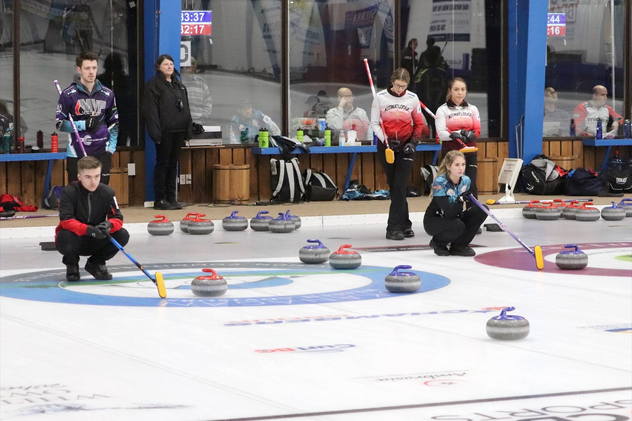 Vernon junior men's skip Erik Colwell looks on as his team delivers a rock while Vernon junior women's third Jaelyn Cotter does the same for her skip Megan McGillivray in Draw 2 action in Vernon on Thursday, Dec. 27, 2018. (John K. White/Morning Star)