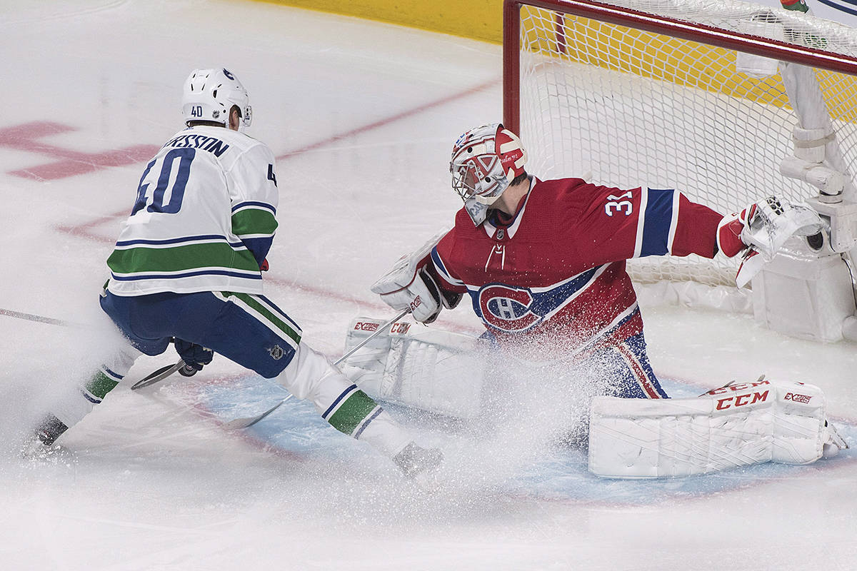 Vancouver Canucks' Elias Pettersson moves in on Montreal Canadiens goaltender Carey Price during first period NHL hockey action in Montreal, Thursday, Jan. 3, 2019. THE CANADIAN PRESS/Graham Hughes
