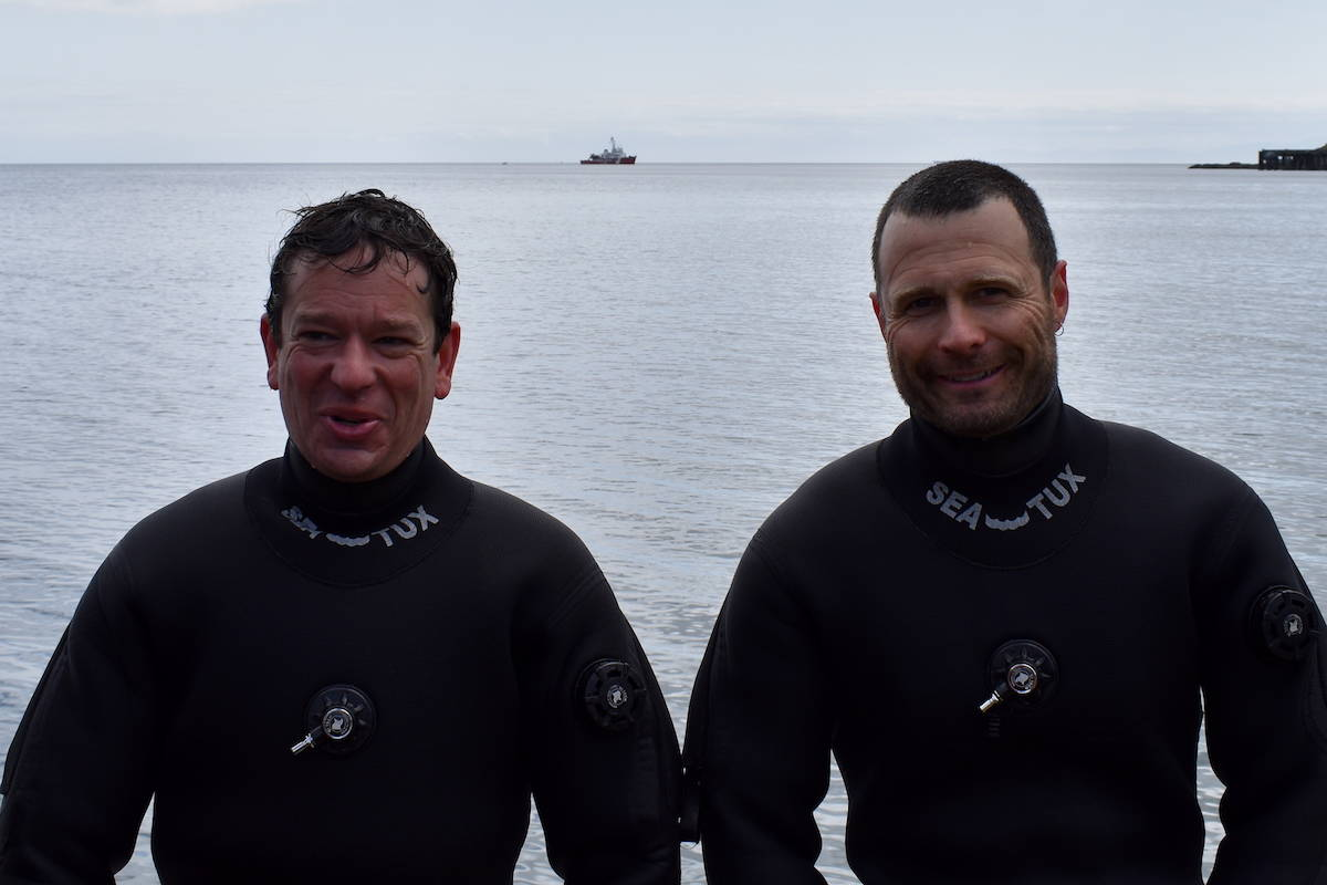DFO scientists Dominique Bureau and Matt Grinnell between dives on board a Canadian Coastguard boat. (Nick Murray/News Staff)