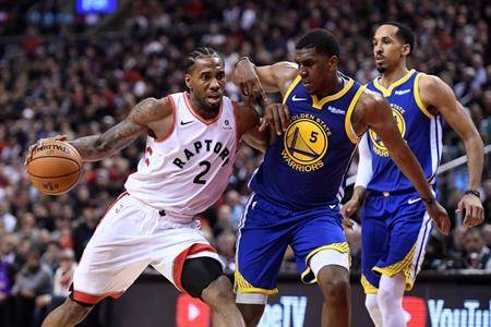 Toronto Raptors forward Kawhi Leonard (2) drives up court as Golden State Warriors centre Kevon Looney (5) defends during second half basketball action in Game 1 of the NBA Finals in Toronto on Thursday, May 30, 2019. (THE CANADIAN PRESS/Frank Gunn)