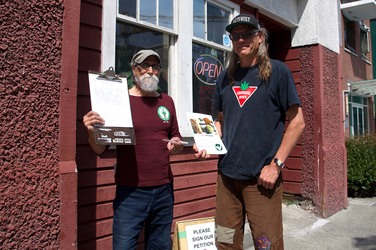 Steve Pittner (left) board member and Ted Smith, Founder of the Cannabis Buyer's Club are going around with a petition to add a variance option to the CRD's Clean Air Bylaw. (Nicole Crescenzi/News Staff)
