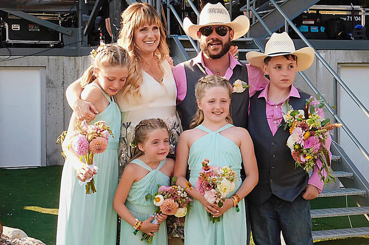 It's a special day for Chris and Nicole and their family after a marriage on stage at Sunfest. (Kelsey McLean/Citizen)