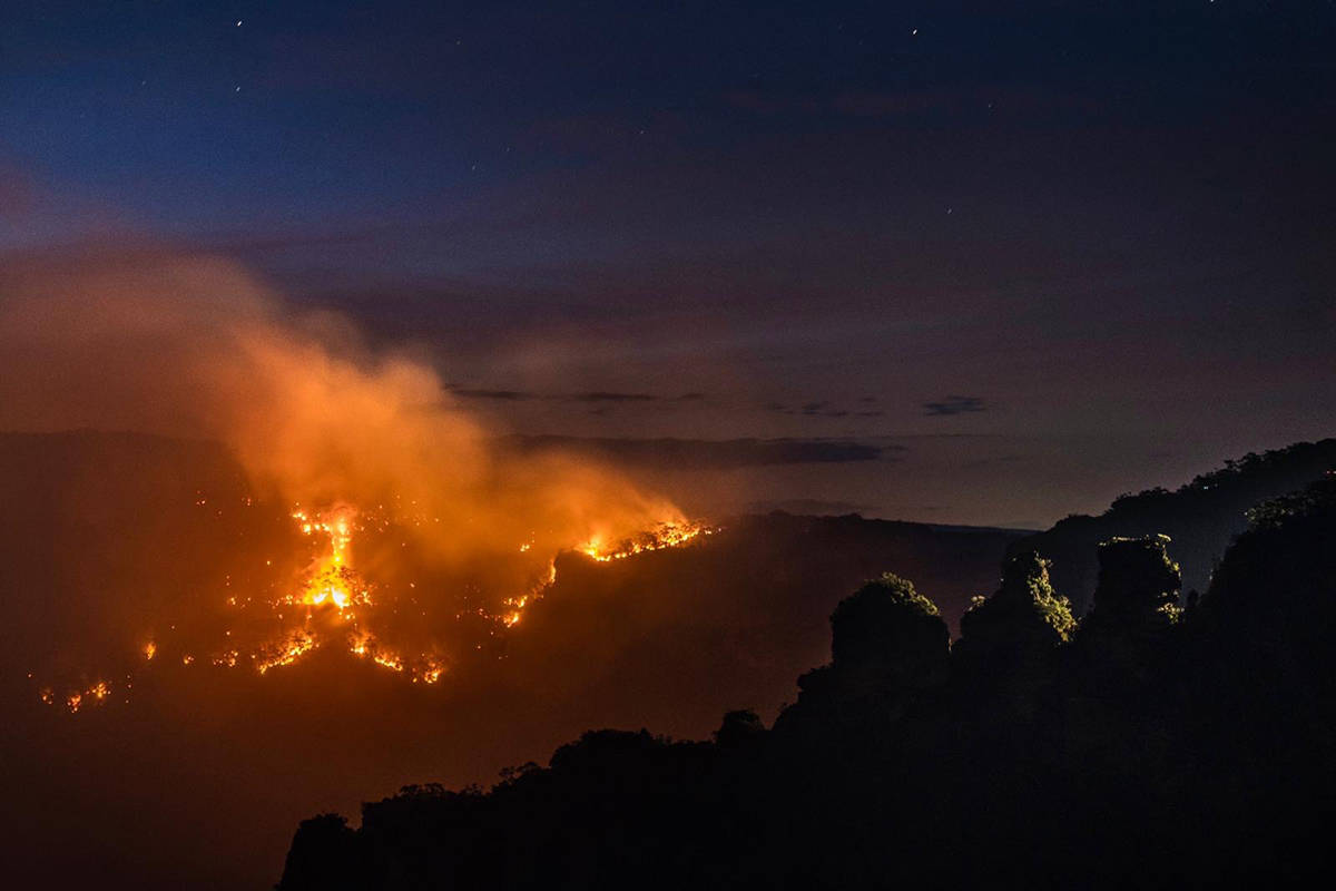 More than 1,750 firefighters and support crew worked overnight on Monday to slow the spread of fire across New South Wales. (Wolter Peters photo/NSW Rural Fire Service)