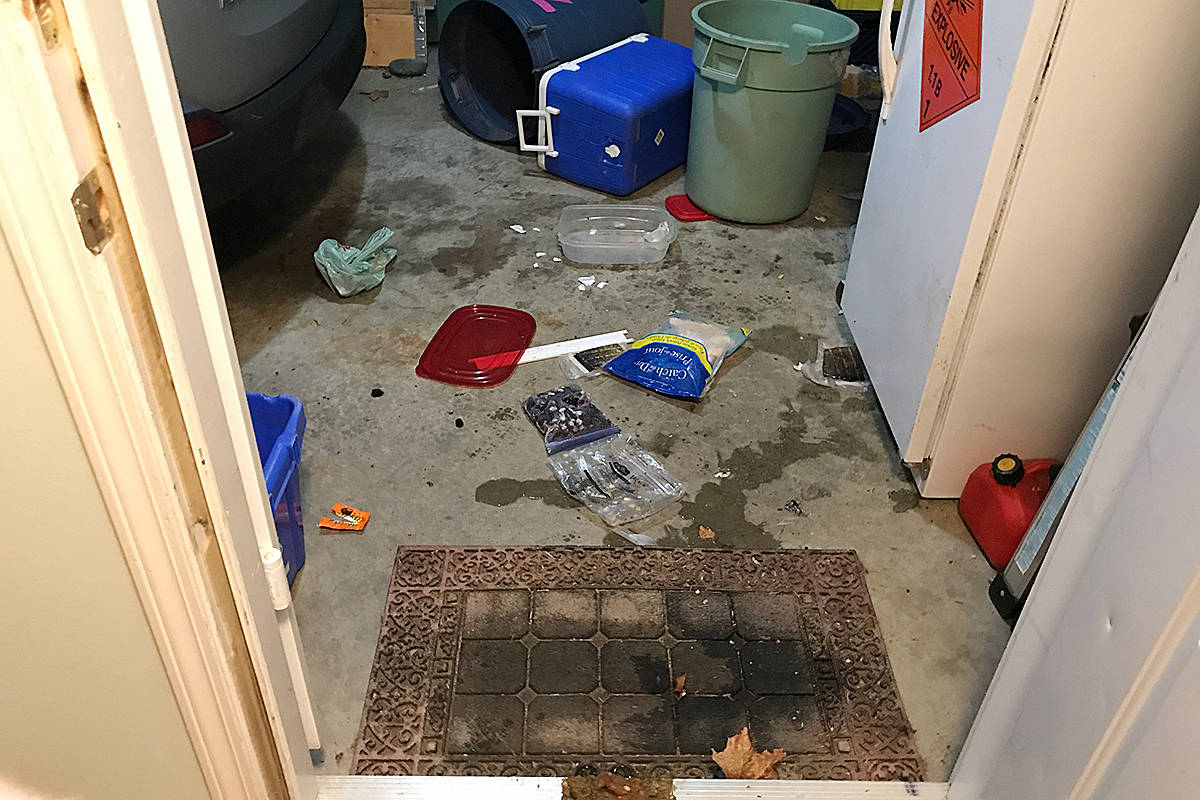 The aftermath of a bear raid on a Campbell River family's freezer is strewn about the carport floor Friday morning. Sharla Marr - photo