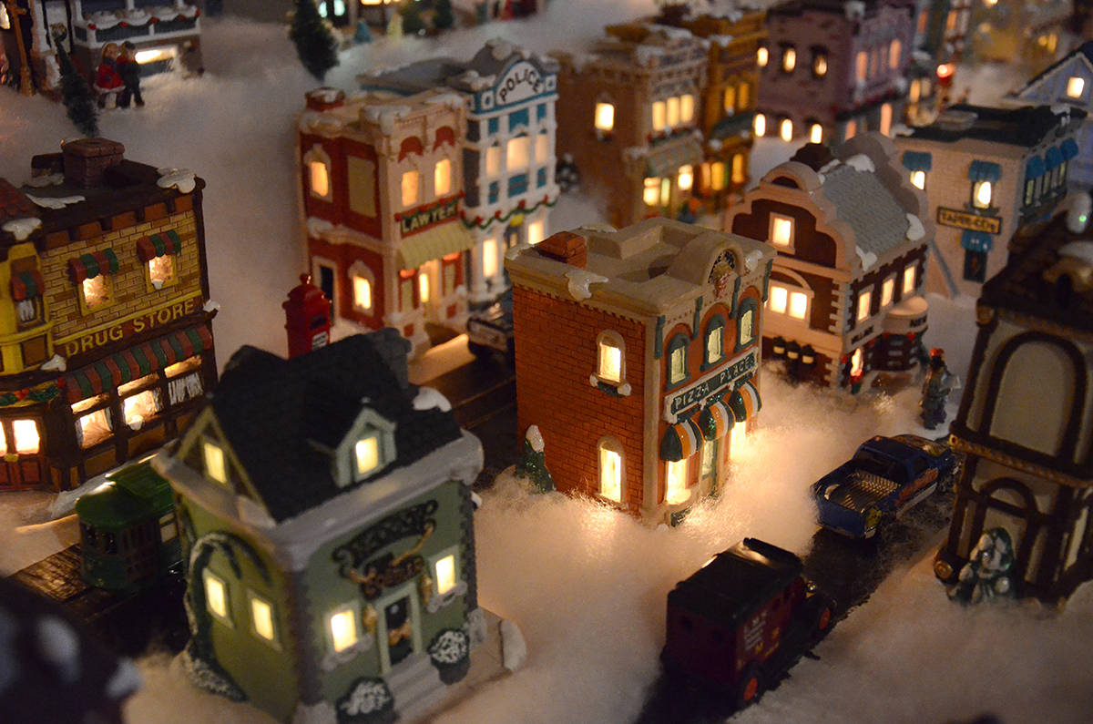 Denise and Jim Madeiros have opened up their Christmas miniature village this year for people to visit. Photo by Mike Chouinard