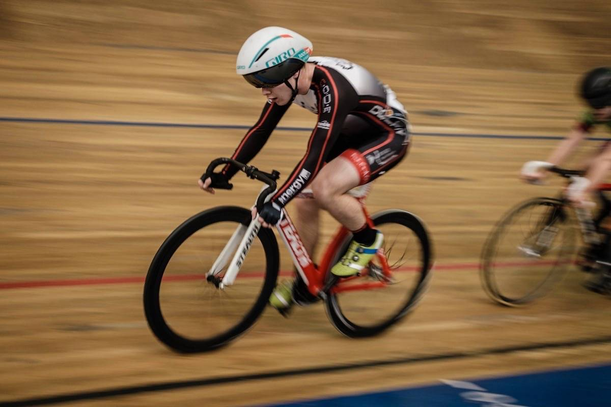 Qualicum Beach cyclist Luke Hubner pedals hard during competition at the Western Track Challenge at the Burnaby Velodrome, Jan. 17. (Filip Funk photo)