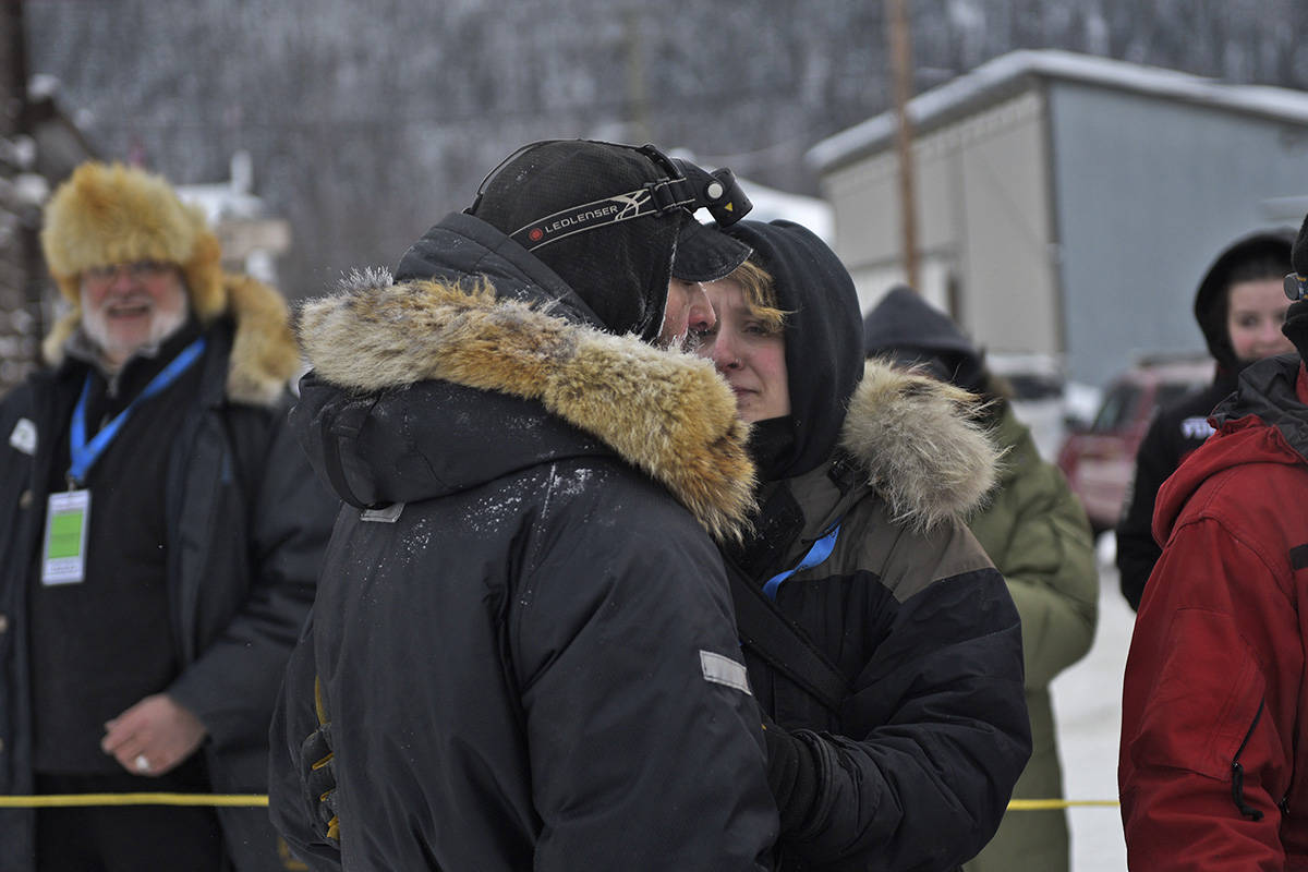 Richie Beattie and his wife Emily Rosenblatt embrace after Beattie was reunited with his team at the Dawson checkpoint on Feb. 7 during the 2020 Yukon Quest (John Hopkins-Hill/Yukon News)