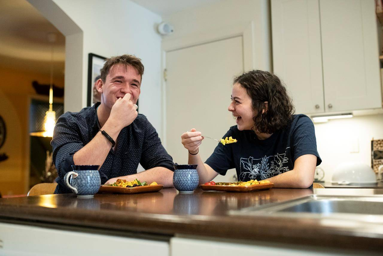 """Nelson Oser-Small, 17, and Mia Kelly, 17, eat tofu scramble they made for breakfast at the Kelly family home in Gatineau, Que., on Saturday, Feb. 15, 2020. Kelly decided to become vegetarian after marching in last fall's climate strike in Ottawa. """"After that, climate change was really on my mind a lot,"""" she said. """"And then I realized that switching to a vegetarian or vegan diet was the biggest thing I could do as an individual."""" Her friend Nelson Oser-Small, 17, has also adopted vegetarianism. THE CANADIAN PRESS/Justin Tang"""