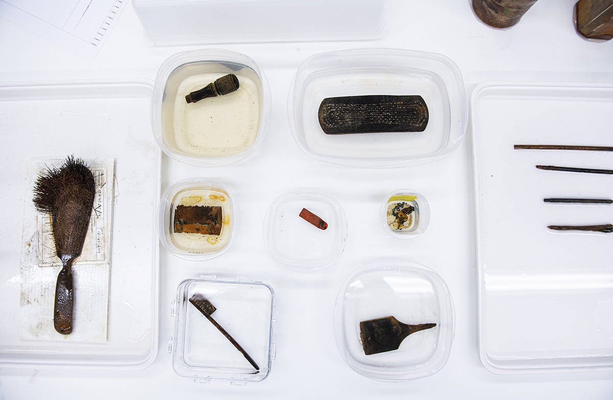 A collection of new artifacts from the wreck of the Franklin Expedition's HMS Erebus, is seen at Parks Canada Conservation Laboratories in Ottawa, on Thursday, Feb. 20, 2020. Artifacts include a hairbrush, handle of a stamp for a seal, clothes brush, comb, piece of sealing wax, chain, toothbrush and paintbrush. THE CANADIAN PRESS/Justin Tang