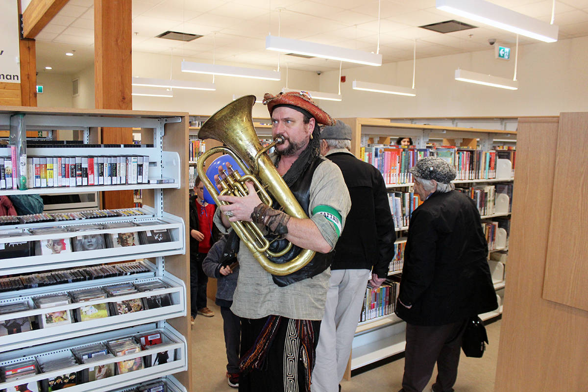 Children's entertainer Captain Thunderpants attracts a following while making his way through the Chemainus library during the official opening Saturday. (Photo by Don Bodger)