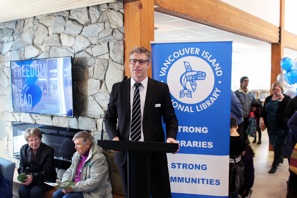David Carson, director of corporate communications for the Vancouver Island Regional Library, at the podium for the Chemainus library's official opening. (Photo by Don Bodger)