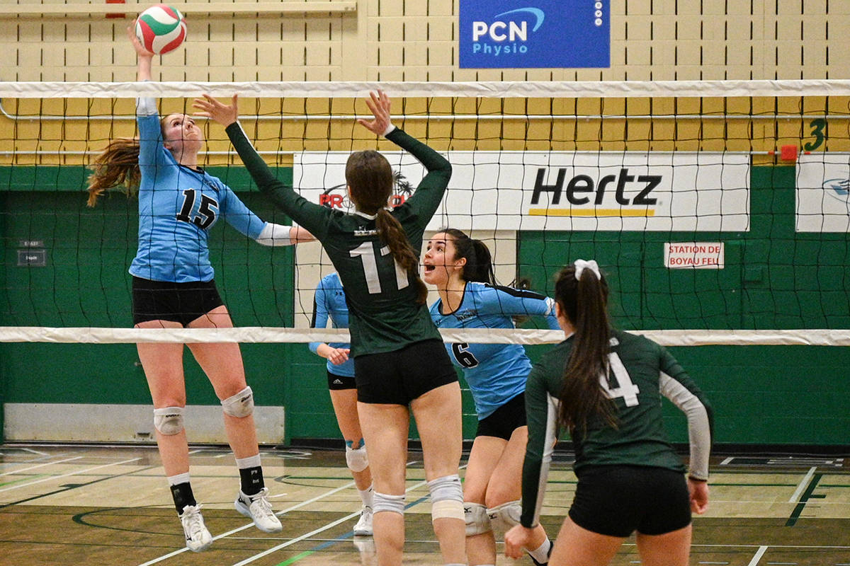 VIU Mariners player Shelby Dorman-Banks goes for a kill as teammate Amanda Dobbyn watches the outcome during Saturday's CCAA gold-medal match against the Élans de Garneau in Quebec. (Canadian Collegiate Athletic Association photo)