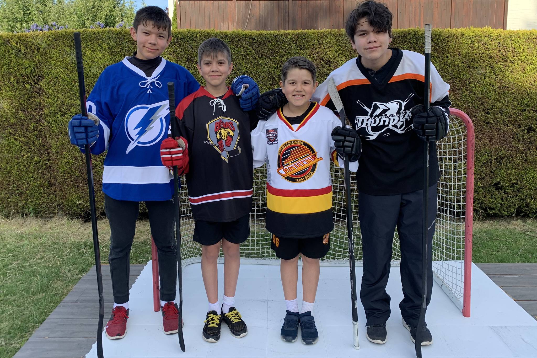 Brothers Caelan, 14, Ryan, 12, Conor, 9, and Brendan Nicolson, 16, in the backyard where they've played a lot of hockey since the March COVID-19 lockdown. (Ryan Nicolson Photo)