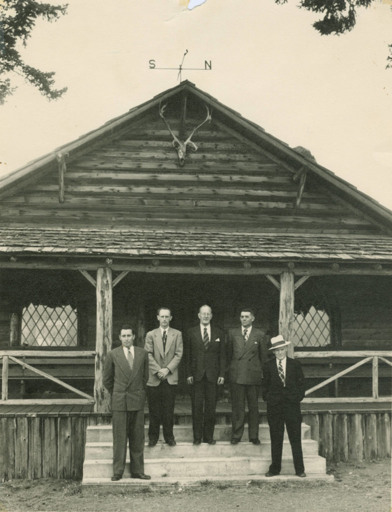 Central Saanich's first council, consisting of Reeve Sydney Pickles, Councillors Harold Andrew, Ray Lamont, Willard Michell and Lorne Thompson, stand outside the Saanich Pioneer Log Cabin, which temporarily housed the municipal offices in 1951 until a municipal and fire hall was built later that year.                                Photo courtesy of Saanich Archives PR-242-2009-043-030