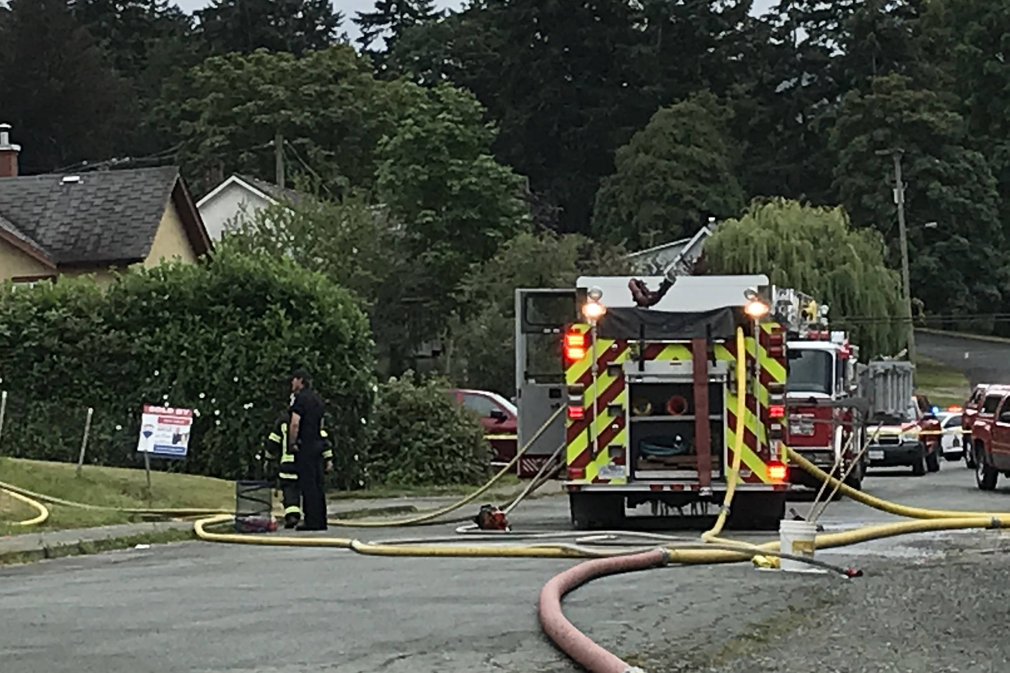 Police, fire and ambulance crews respond to a structure fire in the 3600-block of Fifth Avenue in Port Alberni on Saturday, July 11, 2020. (SUSAN QUINN/ Alberni Valley News)