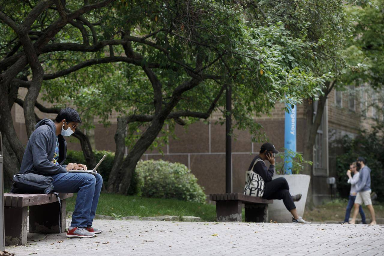 People sit at the Ryerson University campus in Toronto, Tuesday, Sept. 8, 2020. Post-secondary students are paying the same or more tuition compared to last year, including fees for inaccessible facilities as many take classes online. THE CANADIAN PRESS/Cole Burston