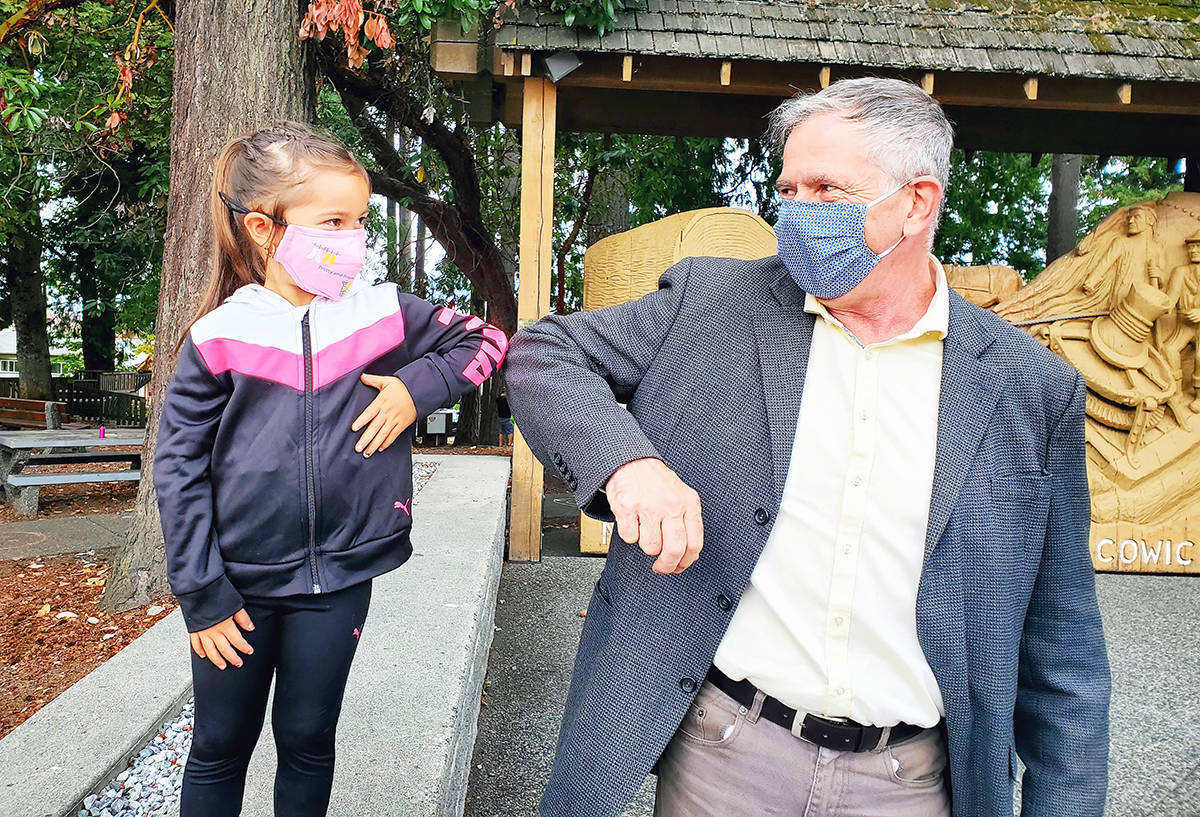 Doug Routley meets and greets young and old alike on the campaign trail for the NDP in Chemainus. (Photo submitted)