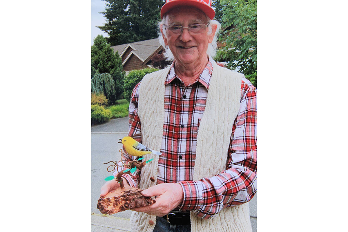 Courtenay artist Bill Bolten recently presented Dr. Bonnie Henry with this carving of a yellow warbler. Photo supplied.