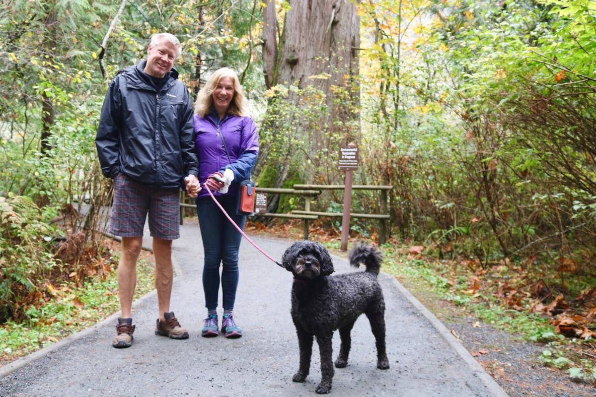 Jeff Nisi (left) and Trudy Curran from East Sooke dropped by Goldstream Provincial Park with their dog, Marley, on a quiet Sunday afternoon. (Aaron Guillen/News Staff)