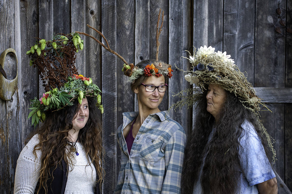 Megan Dunn, Sonja Zupanec and Sue Dunn (from left) created floral headpieces as part of a fundraiser for the People for a Healthy Community on Gabriola Society food bank. (Photo courtesy Jeanette Martin)