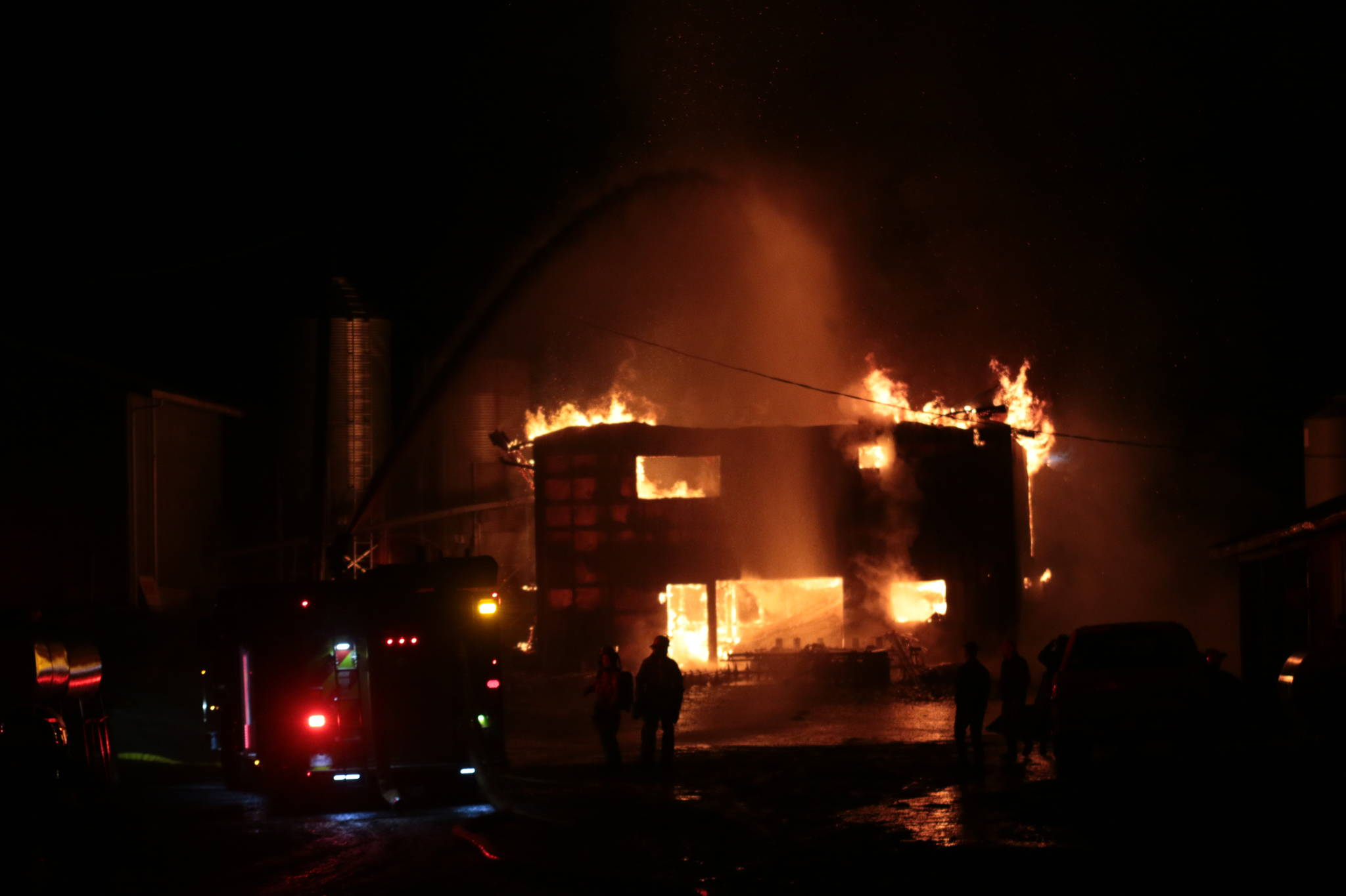 A structure fire at Farmer Ben's on Herd Road Sunday night called for crews from three fire departments to battle the blaze. (Kevin Rothbauer/Citizen)