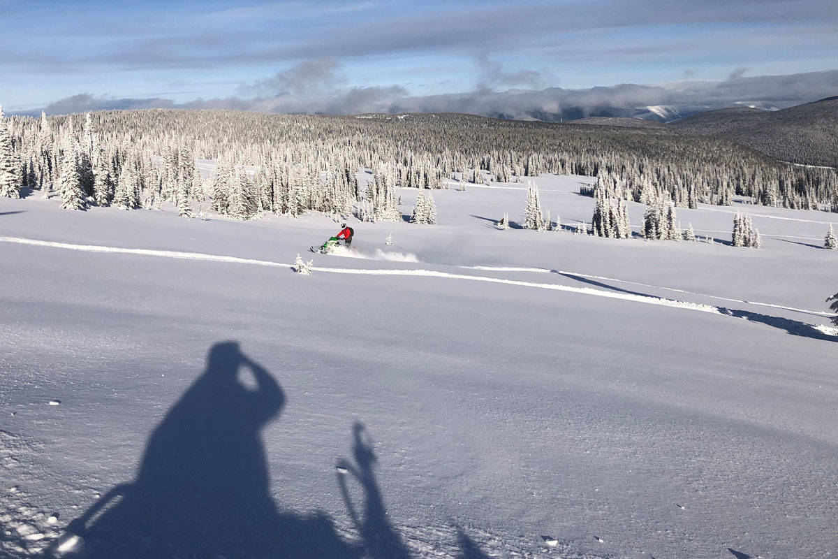 A rider carves a path on Yanks Peak Saturday, Nov. 21. Two men from Prince George went missing on the mountain the next day. One of them, Colin Jalbert, made it back after digging out his sled from four feet under the snow. The other, Mike Harbak, is still missing. Local search and rescue teams went out looking Monday, Nov. 23. (Sam Fait Photo)