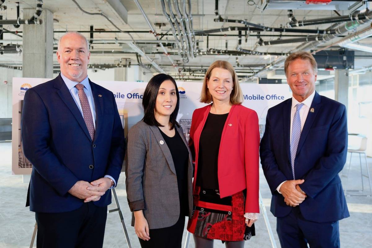 (left to right) BC Premier John Horgan, government employee Su-Mei MacDonnell, MLA for Esquimalt-Metchosin Mitzi Dean, and Langford Mayor Stewart Young at the announcement of a new government space located in Langford in November 2019. (Black Press Media file photo)