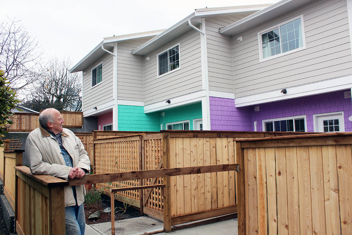 Jon Lefebure checks out the back of The Cottages On Willow that contains three more colourful rental units. (Photo by Don Bodger)