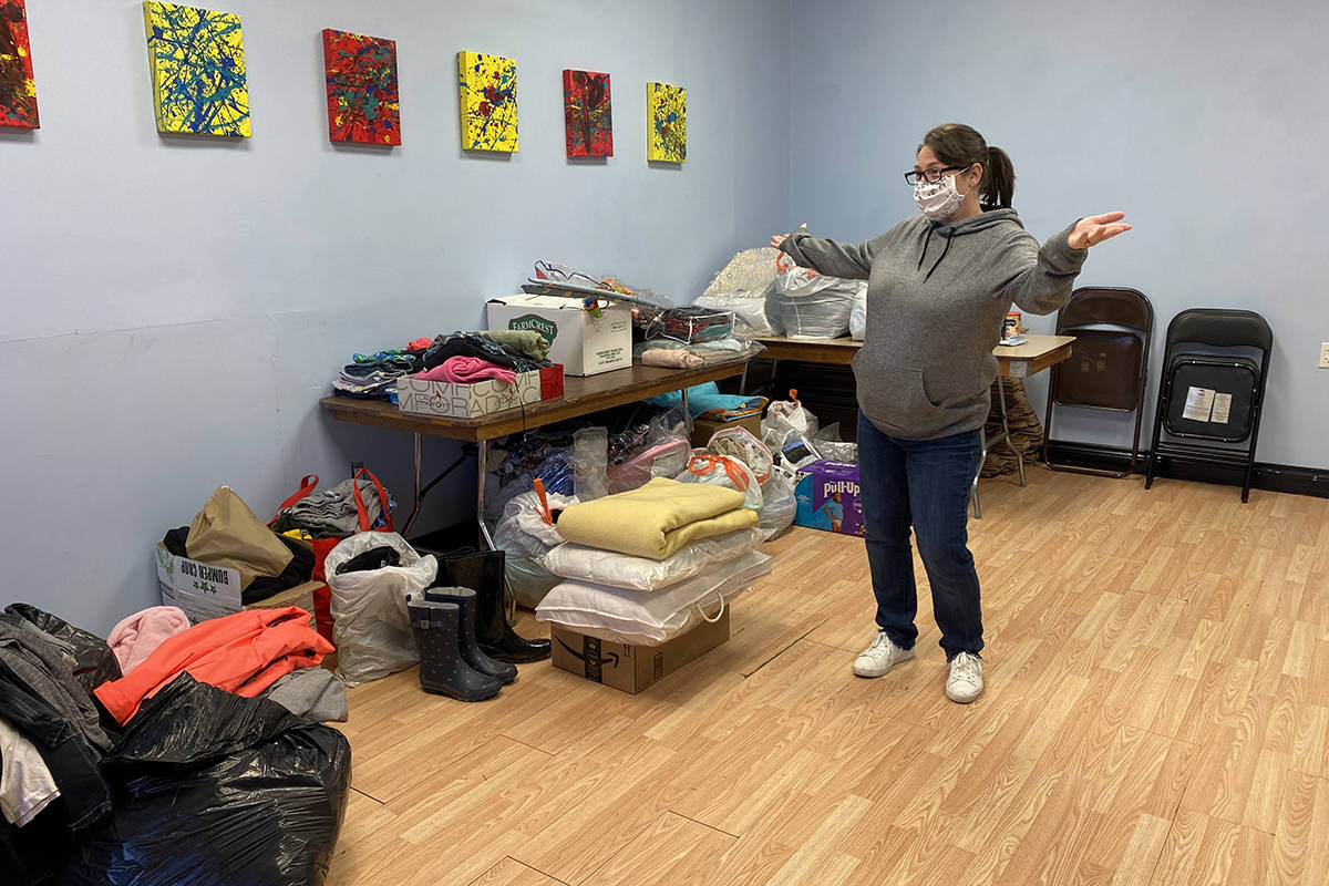 Michelle Lau with donations that have already been contributed for families kept away from home due to the Town Park Apartments fire. (Zoe Ducklow Photo)