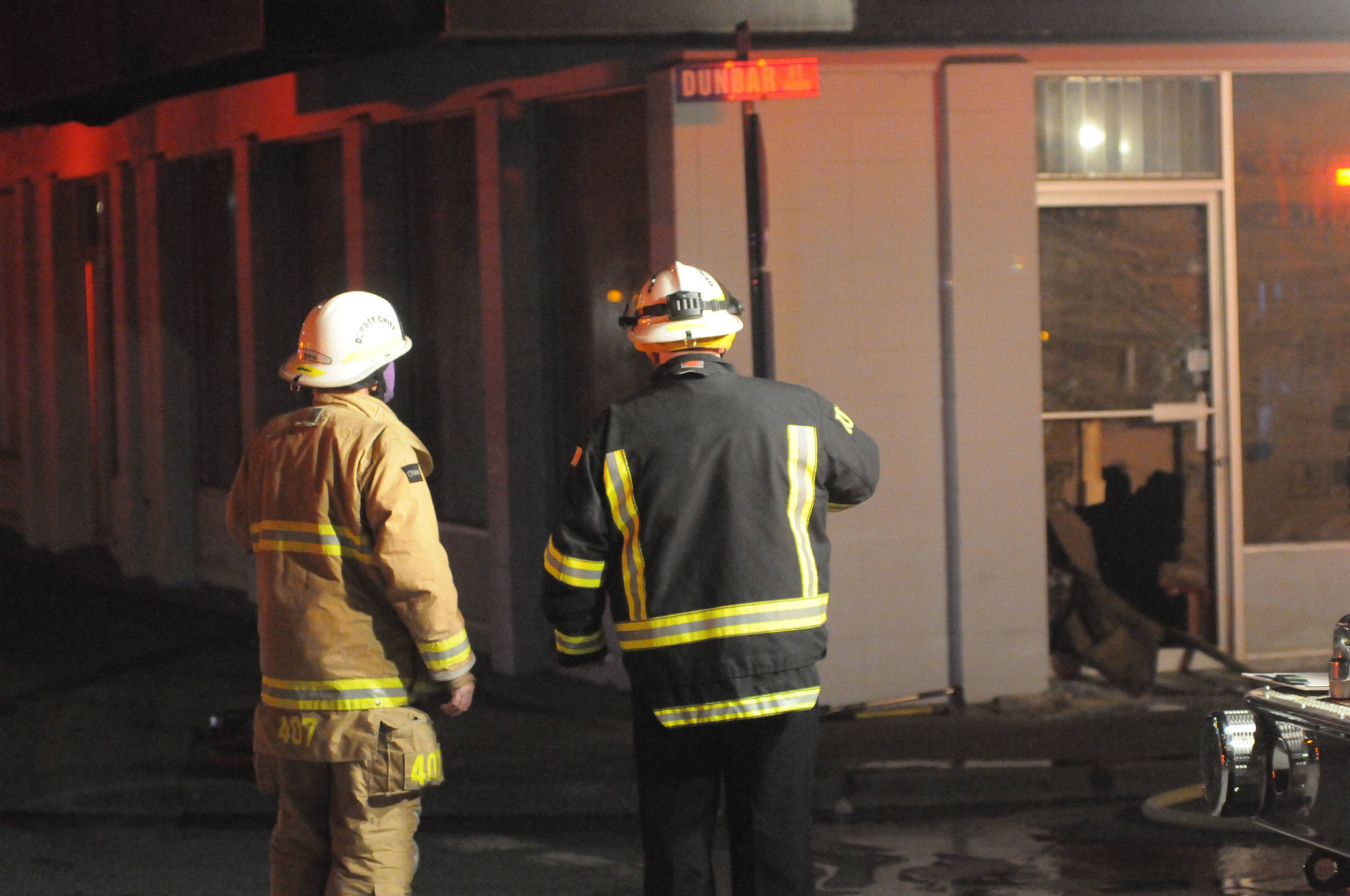 Port Alberni Fire Department deputy Chief Wes Patterson, right, and another unidentified firefighter discuss the situation at the former Acklands-Grainger building at Third Avenue and Dunbar Street, Thursday, Jan. 21, 2021. No fire was detected in the building. (SUSAN QUINN/ Alberni Valley News)