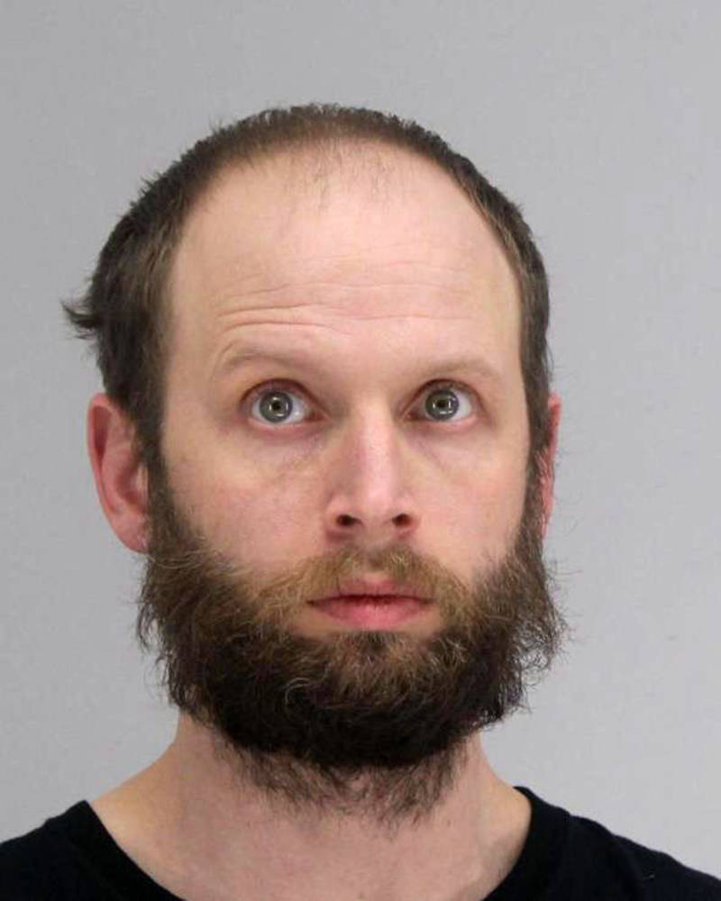 This photo provided by the Dallas County Sheriff's Office shows Garret Miller. Miller has been arrested for allegedly taking part in the storming of the U.S. Capitol this month and posting violent threats, including a call to assassinate Democratic Rep. Alexandria Ocasio-Cortez of New York. Garret Miller, who is from the Dallas suburb of Richardson, was arrested Friday, Jan. 22, 2021 after being named in a five-count federal complaint. (Dallas County Sheriff's Office via AP)