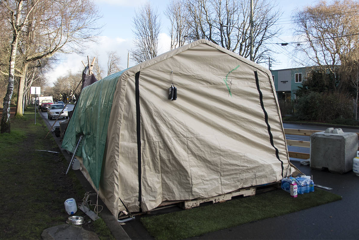 The community services tent for people in need has found a home near Cook Street and Dallas Road. The Beacon Hill Park trust has prevented the tent from being installed inside park boundaries. (Nina Grossman/News Staff)