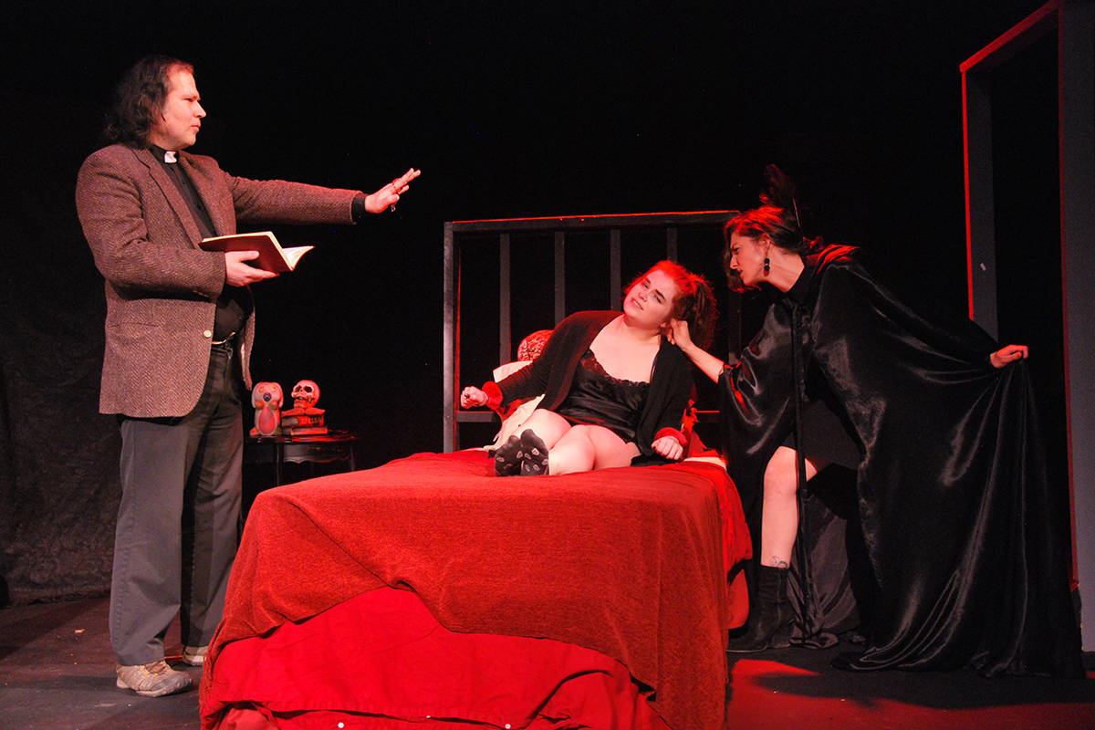 William Anderson's Father Francis attempts an exorcism on Danni, played by Whitley Dunn, to remove demon Nicole Potvin (from left) in 'Dispossessed, or Danni's Inferno' by local playwright Sean Enns at the 2019 New Waves Festival. This year's festival is taking place online. (Bulletin file photo)