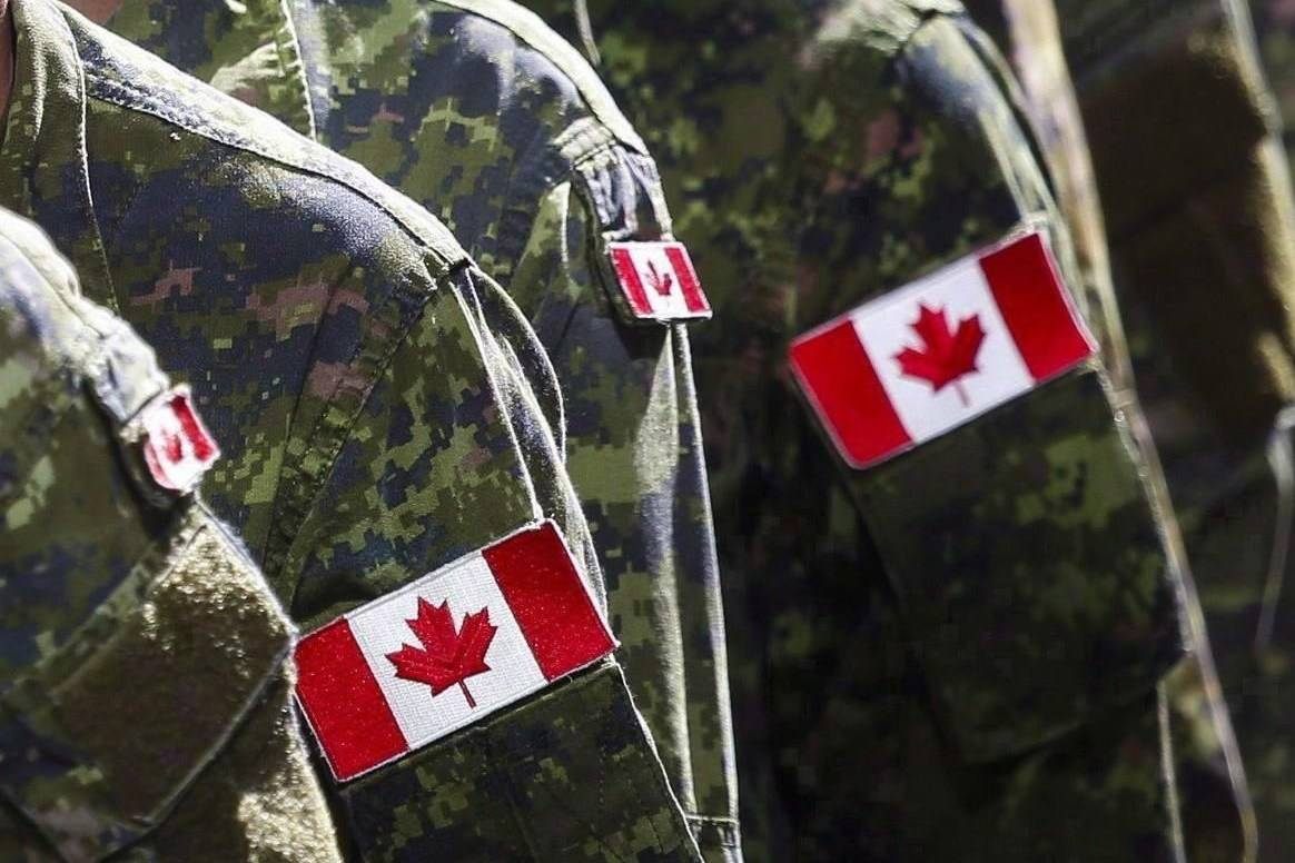 Members of the Canadian Armed Forces march during the Calgary Stampede parade in Calgary, Alta., Friday, July 8, 2016. The Canadian Armed Forces is facing a shortfall of several thousand troops thanks at least in part to challenges training new recruits during the COVID-19 pandemic. THE CANADIAN PRESS/Jeff McIntosh