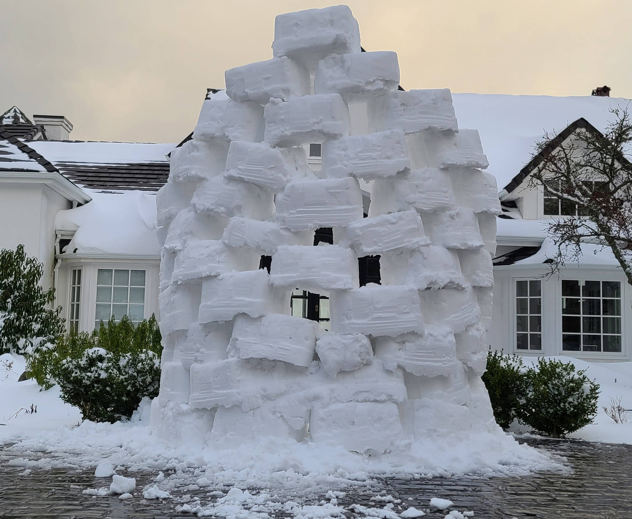This snow wall appeared Saturday in front of a Saanich neighbourhood. No word who paid for it. (Courtesy of Myron P)