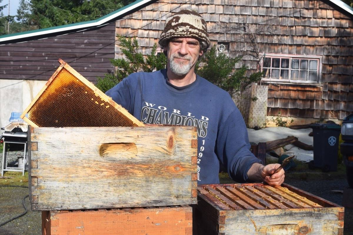 Todd Laplante cleans some of his beekeeping equipment at his Port Alberni home. (ELENA RARDON / ALBERNI VALLEY NEWS)