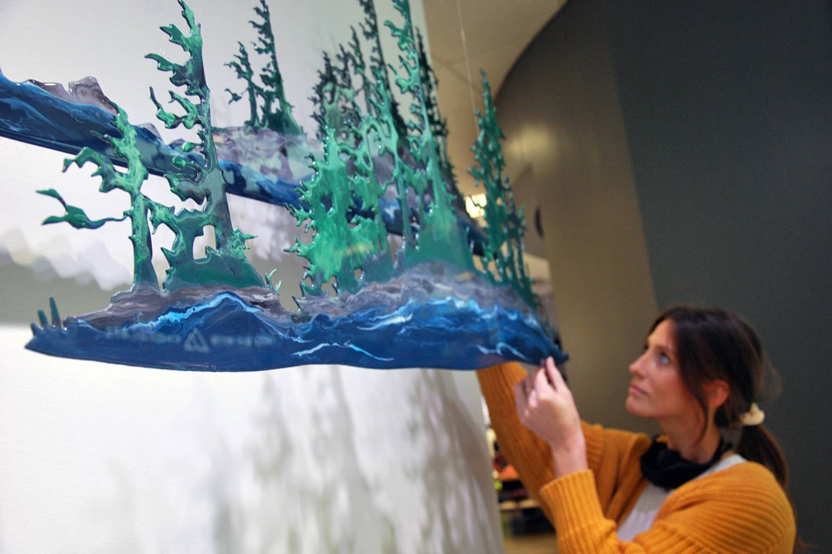 West Coast-themed metal art by Nanaimo artists Hayley Willoughby (pictured), her father Jack and partner Blair LeFebvre is on display in the window of Lululemon at Woodgrove Centre from now until March 13 as part of the store's monthly local artist program. (Josef Jacobson/The News Bulletin)