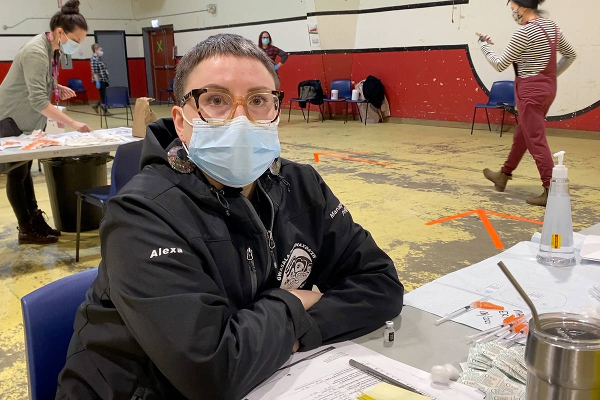 Nurse Alexa Bisaillon waits with needle prepped for her next immunization patient at Wakas Community Hall on the Tsulquate Reserve. (Zoë Ducklow photo)