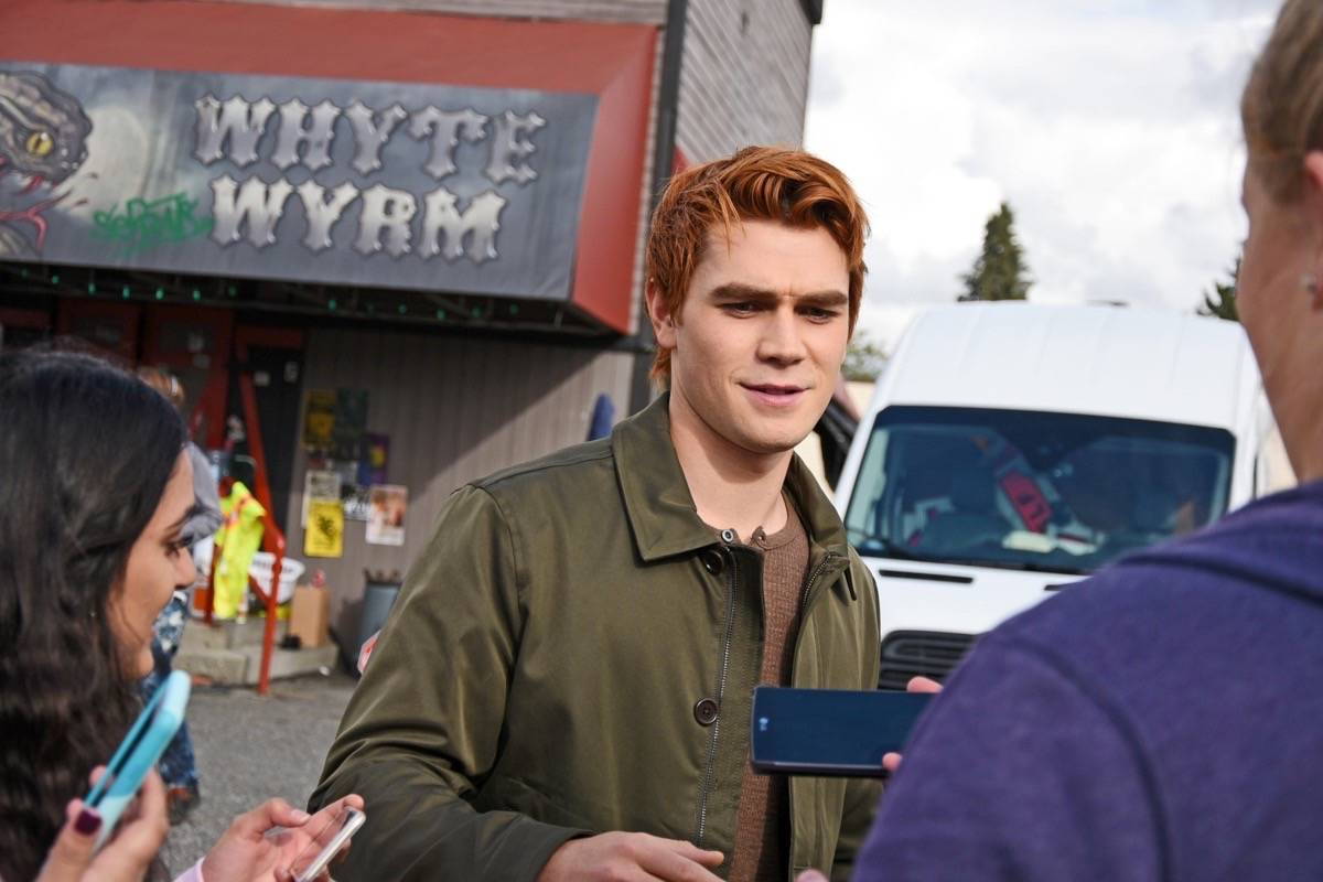 "Actor KJ Apa, who plays the character Archie in Riverdale, snaps a photo with a fan outside of Gabby's Country Cabaret, aka the ""Whyte Wyrm"" while filming for the show on the mainland. (Black Press Media file photo)"
