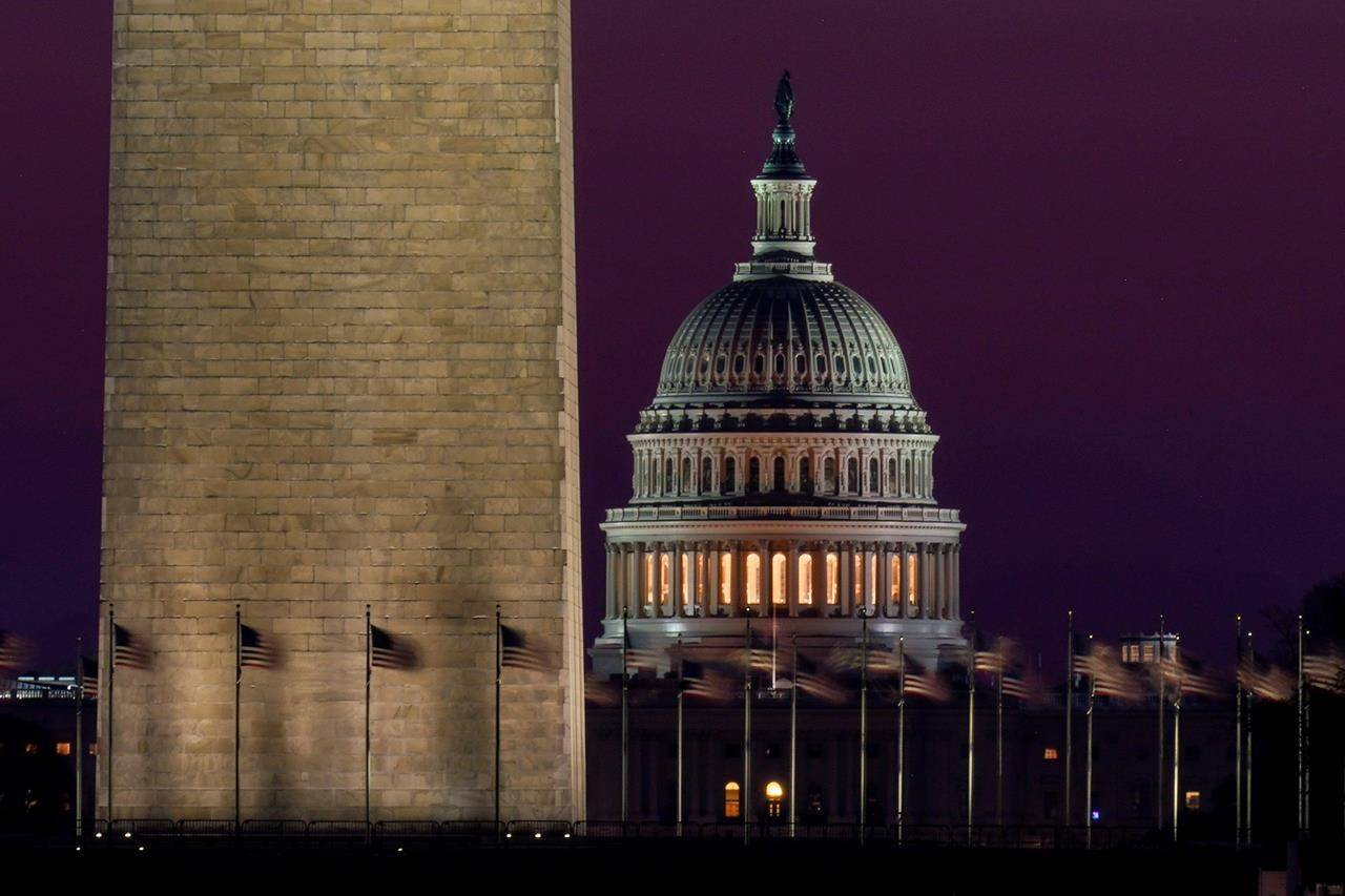 The Capitol is seen beyond the base of the Washington Monument before sunrise in Washington, Wednesday, March 10, 2021. (AP Photo/Carolyn Kaster)