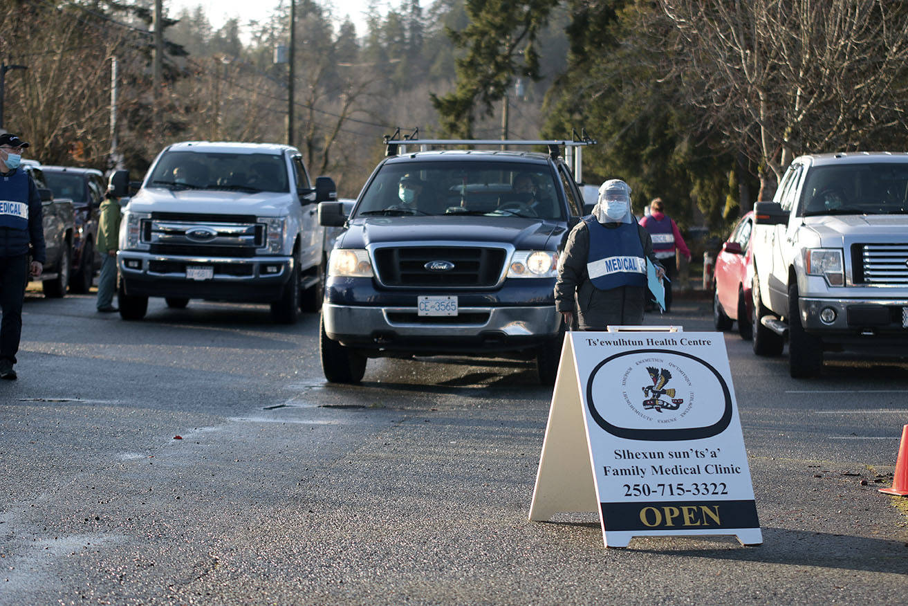 Cowichan Tribes members line up at a drive-up clinic on Wednesday, Jan. 13 to receive the first doses of the COVID-19 vaccine in the region. (Kevin Rothbauer/Citizen)
