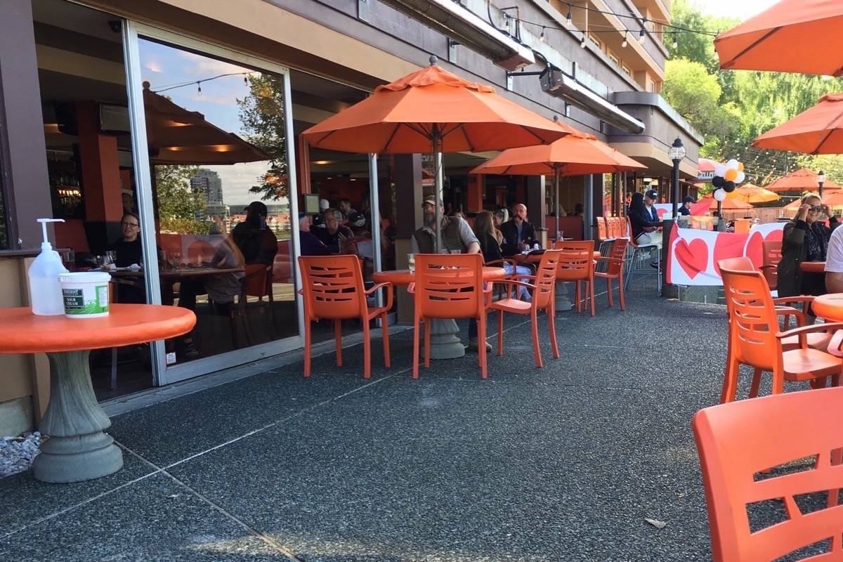Pub patio in Victoria reopens with widely spaced tables, June 2020, after initial COVID-19 shutdown of indoor dining in B.C. (Tom Fletcher/Black Press)